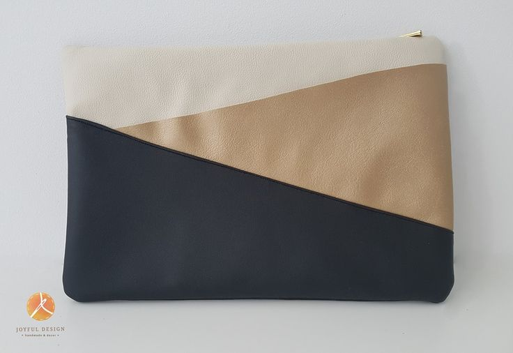 Gold-black-white clutch