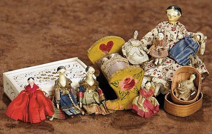 Wonderful Collection of 8 Tiny Grodnertal Wooden Dolls.