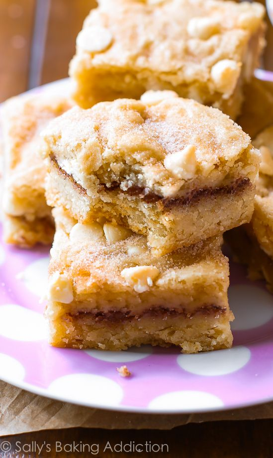 White Chocolate Snickerdoodle Blondies are a must make - a cross between a chewy blondie, a soft cinnamon sugar cookie, and a buttery cake! Recipe at sallysbakingaddiction.com