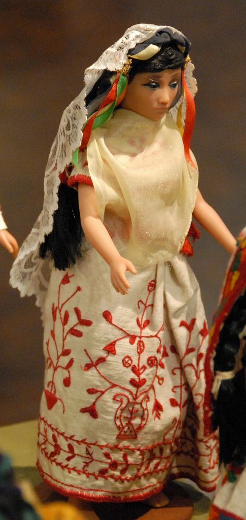 """This doll is a part of the Zuno de Echeverria collection of Mexican costume dolls. She is wearing the famous """"tree of life"""" skirt from the Totonac community of Papantla, Veracruz. The lace covering the back of her head is her quechquemitl cape. Museo de Arte Popular (MAP) Mexico City"""