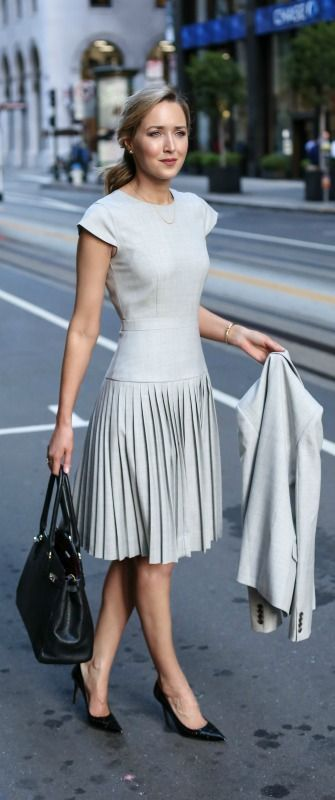 Neutral grey dress, Capped sleeves emphasise width at shoulders, pleats work with hips and waist appear slim in the middle