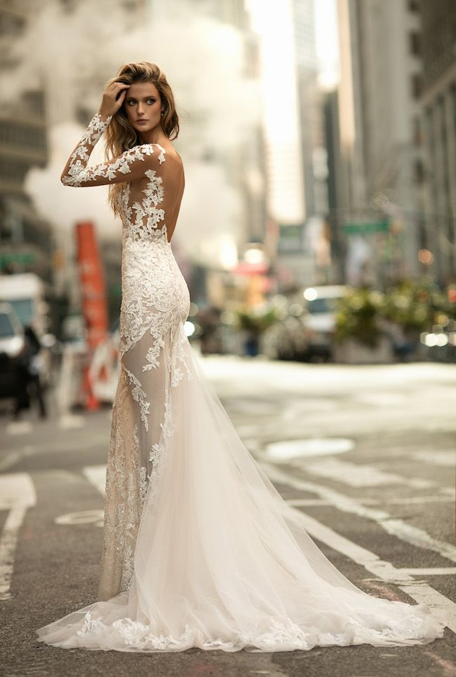 A mermaid gown with long, sheer panels is paired with strategically-placed, opaque, form-fitting lace to create a sensual peek-a-boo effect on a BERTA wedding dress that is provocative, yet still elegant. http://www.confettidaydreams.com/berta-wedding-dresses/  via @confettidaydreams featuring @bertabridal