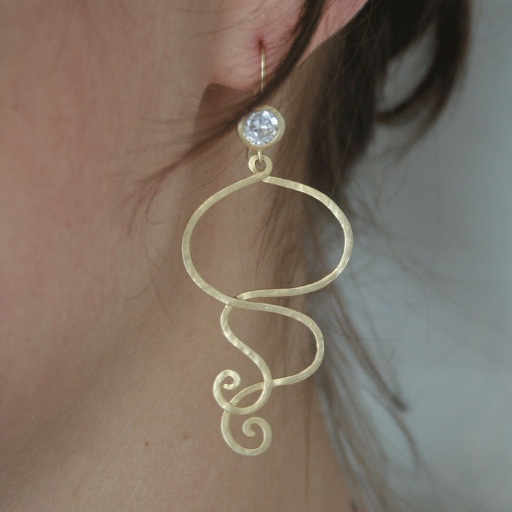 Earrings. Cool swirl earrings! Matte gold coated brass.