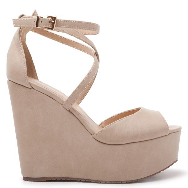 High heel suede platforms in beige colour and cross over straps. Fasten with adjustable suede ankle strap.