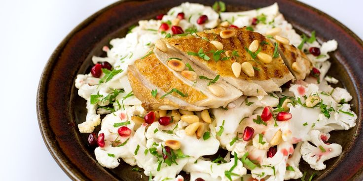 Chargrilled chicken with cauliflower pomegranate and toasted pine nut salad
