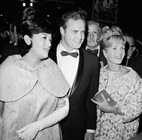 Movita Castaneda, Marlon Brando, and Debbie Reynolds photographed at the premiere of Mutiny on the Bounty in 1962.