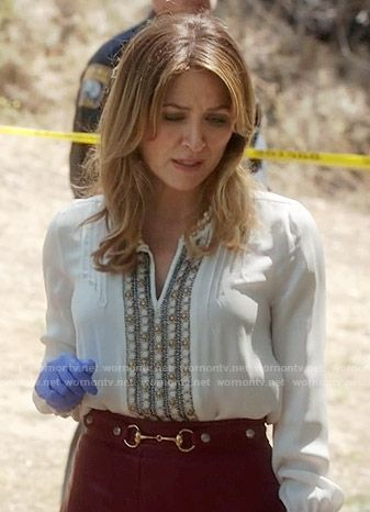 Maura's white embellished blouse and red pleated leather skirt on Rizzoli and…