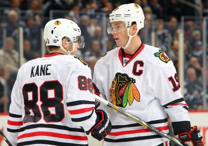 WINNIPEG, MB - NOVEMBER 21: Patrick Kane #88 and Jonathan Toews #19 of the Chicago Blackhawks discuss strategy during first period action against the Winnipeg Jets at the MTS Centre on November 21, 2013 in Winnipeg, Manitoba, Canada. (Photo by Jonathan Kozub/NHLI via Getty Images)