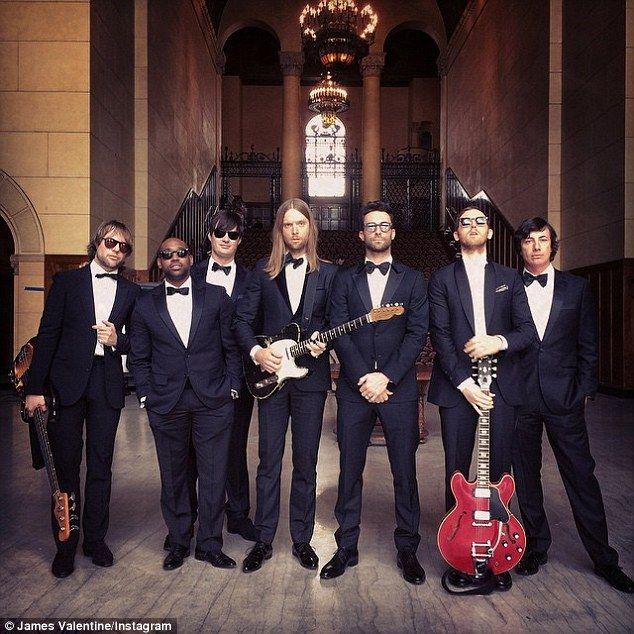 Keeping it safe? Adam Levine and Maroon 5 donned black tuxes for the band's new music video, rumoured to be for the single Sugar, in Beverly Hills, California on Saturday