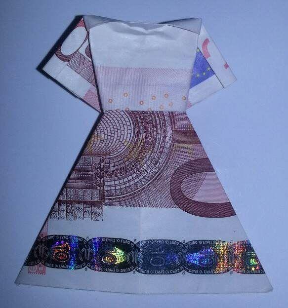 Diese Faltanleitung zeigt, wie aus einem Geldschein ein nettes Kleid gefaltet wird. Eine Foto-Faltanleitung für ein kreatives Geldgeschenk.