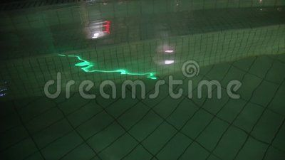 Thermal pool at night - light reflection on the water surface.