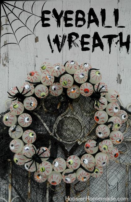 How to make an Eyeball Wreath using ping pong balls, snakes and spiders. Tutorial on HoosierHomemade.com