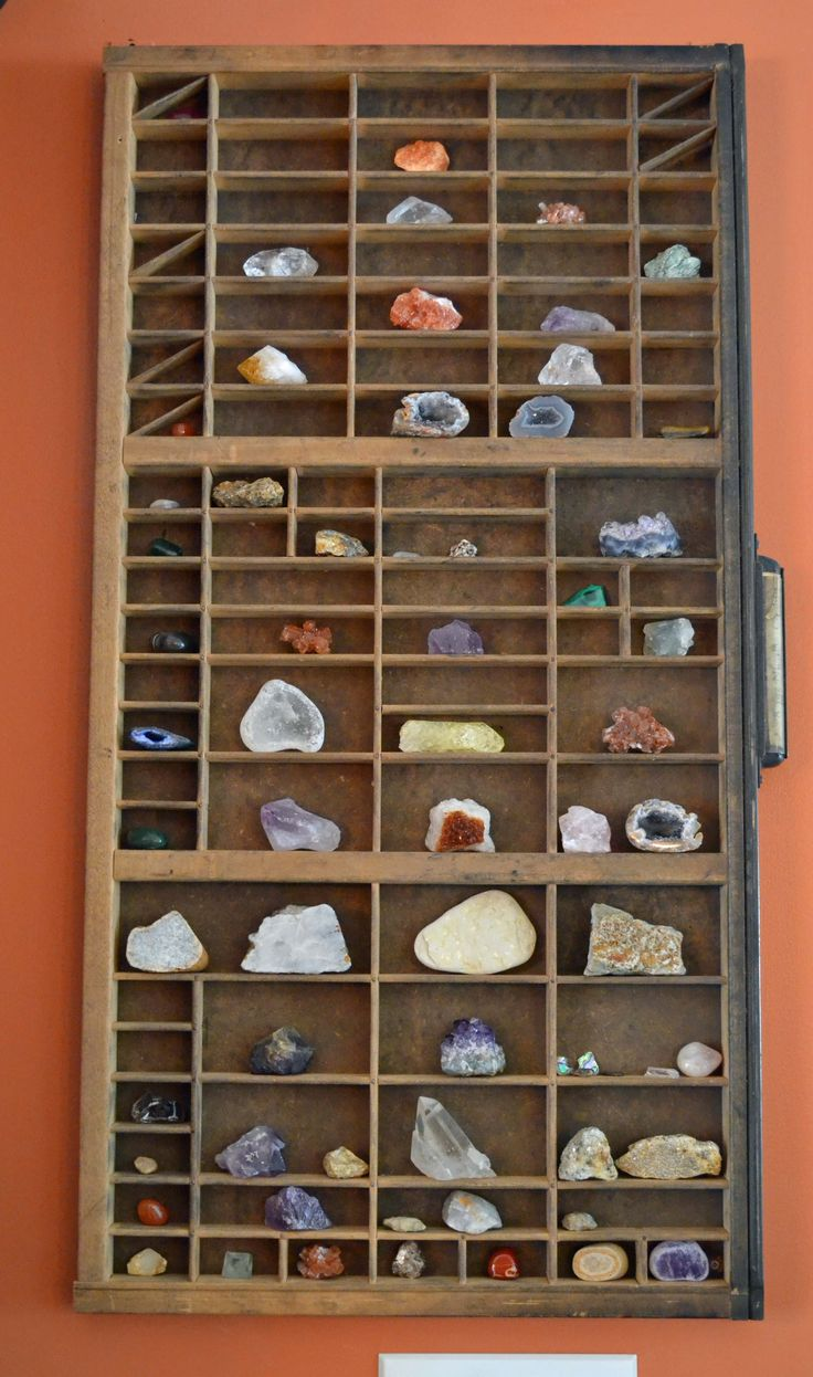 Hung an antique printers drawer on the wall to showcase our sons rock/mineral  collection