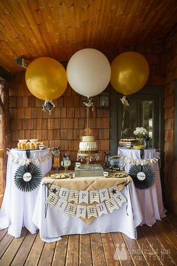 Black and Gold Decorations for a 50th Birthday Party. I love the great big balloons! #50thBirthdayPartyIdeas #50thBirthdayIdeas