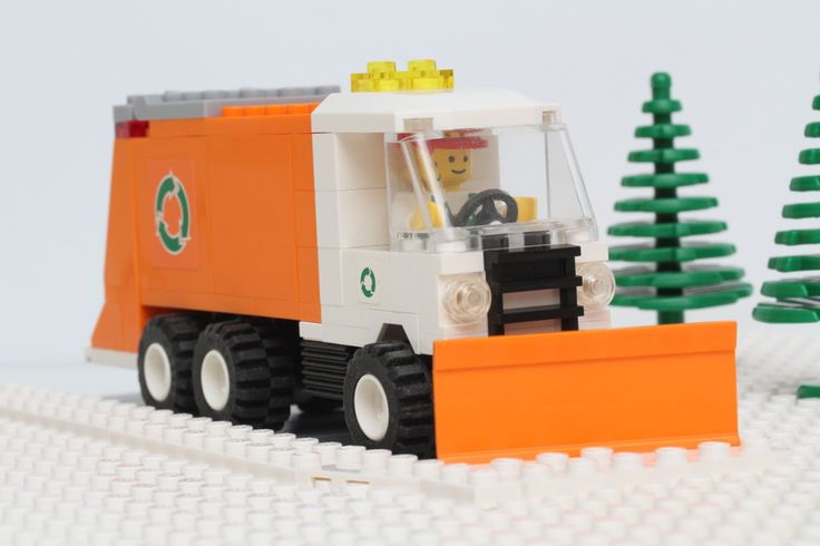 https://flic.kr/p/pZ9gjs | Garbage Truck Snow Plow | Is your LEGO city or town on a tight fiscal budget and buried in snow?  Not enough tax revenue for dedicated snow removal equipment?  Fear not, we have an economical solution with the ABS snow plow attachment for your garbage trucks. Put your garbage trucks to double duty while collecting the trash on the same snow covered streets. You can realize more savings by using 4 wide trucks instead of 6 or 8 wide since they require less ABS…