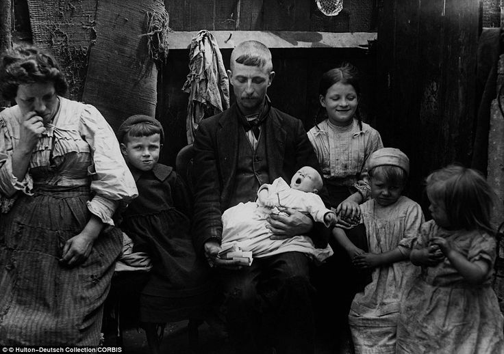 Poverty-stricken: Victorian families like this one in the late 19th century had to endure low life expectancy rates caused by squalor, disease and starvation.