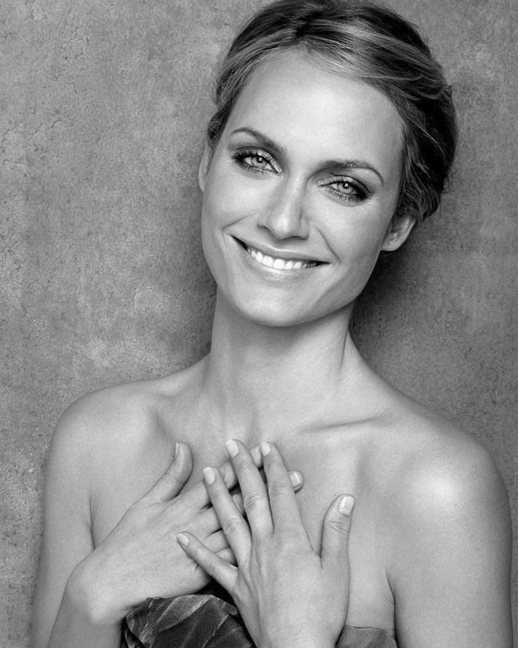 Amber Valletta smiles in black and white tint