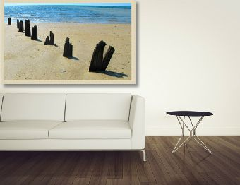 Choose photographs/artworks that lead your eyes through. This will give a sense of space to a room.