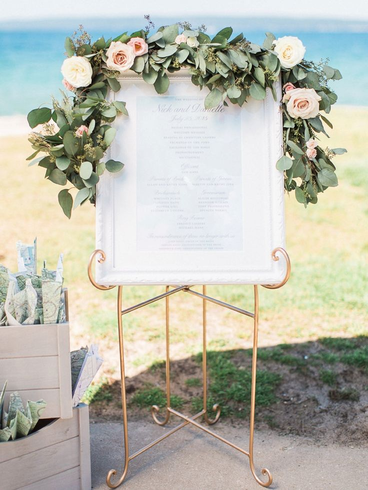 Wedding ceremony program complete with a blush and white floral garland by Hey Gorgeous Events | Bradley James Photography