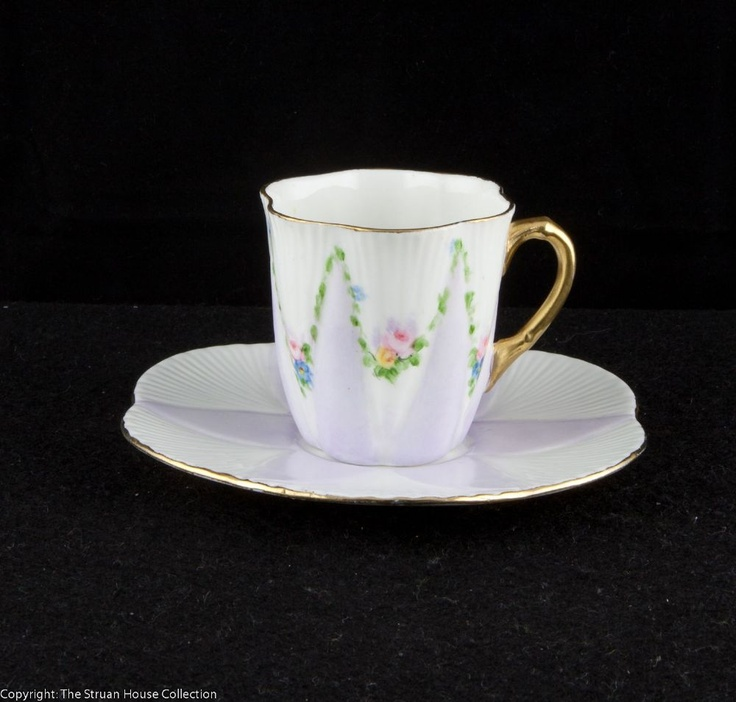 A delightfully delicate set of coffee cup and saucer in the popular Dainty shape introduced by Wileman in 1896 and designed by Rowland Morris