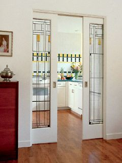 stained glass pocket doors between a kitchen and dining room