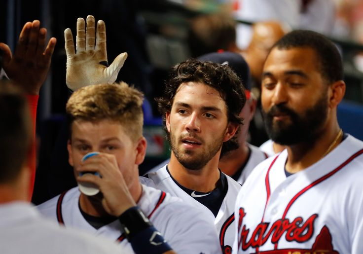 Dansby Swanson #2 and Gordon Beckham #7 of the Atlanta Braves react after scoring on a two-RBI single hit by Ender Inciarte #11 against the San Diego Padres in the sixth inning at Turner Field on August 31, 2016 in Atlanta, Georgia. (Photo by Kevin C. Cox/Getty Images)