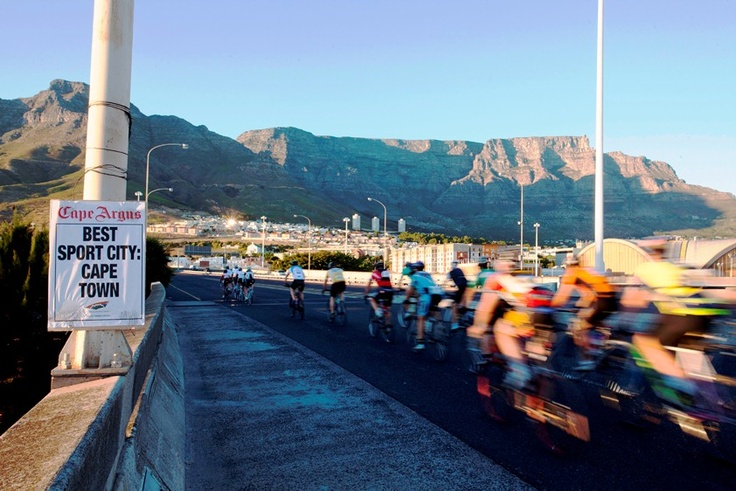 Cyclists with a view of one of the Seven Wonders of the World, Table Mountain