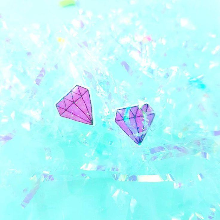 Purple glitter diamond earrings on minty glittery fluff