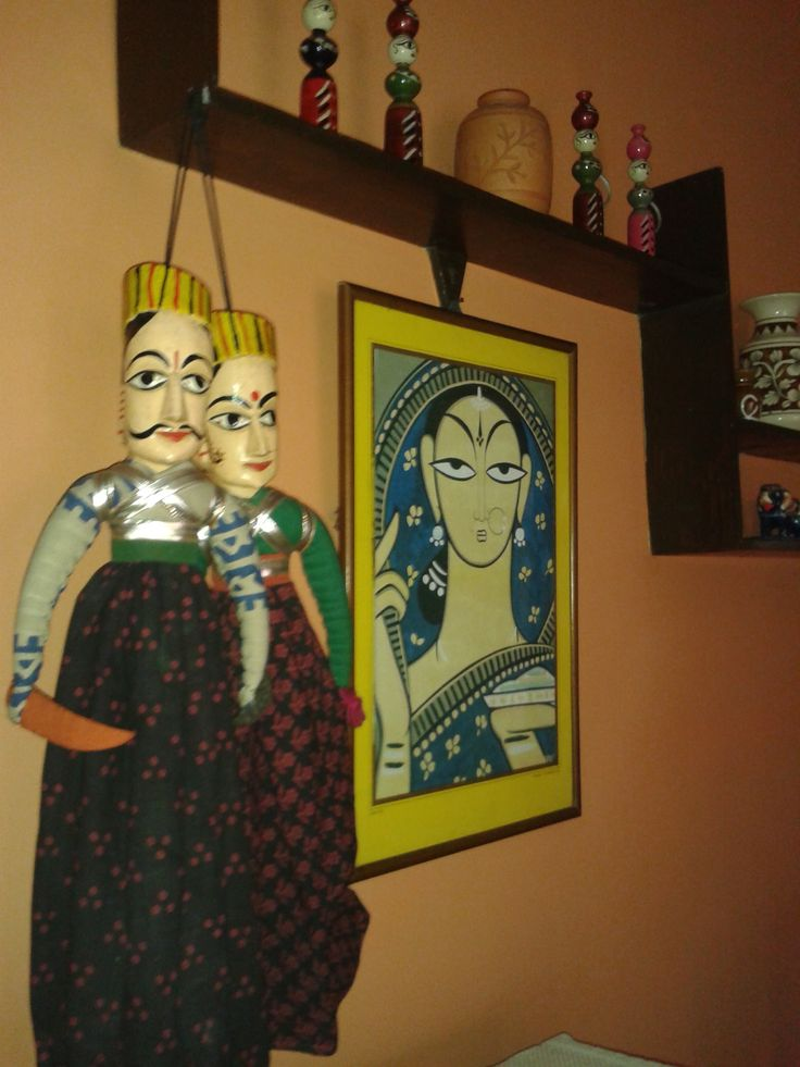Ethno Indian Decor Style Featuring Cloth Puppets Jamini Roy Painting And Wooden Showpieces From Living Room