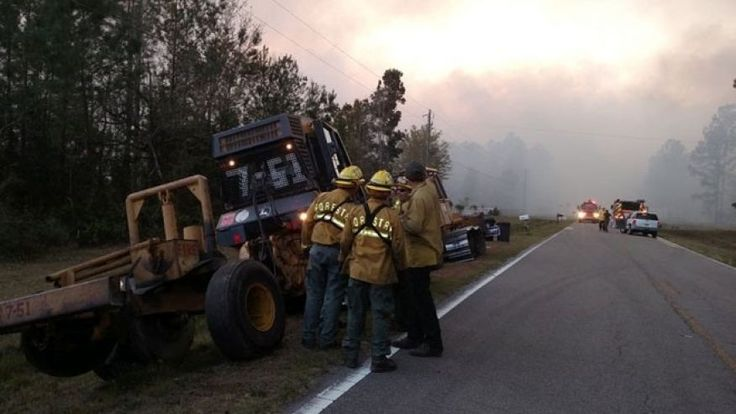 Firefighters arriving to battle a fire in Nassau County, Fla., last March.