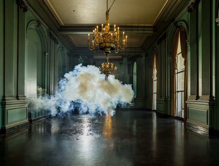 Indoor Clouds! Dutch artist Berndnaut Smilde controls the weather and creates beautiful indoor clouds with the help of a smoke machine. Fog machine emits dense vapor / smoke that makes contact with sprayed water and forms small white cloud. Miniature cloud floats through the room and quickly disappears.