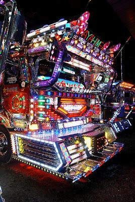 """Dekotora - デコトラ an abbreviation for """"decoration truck"""" extravagantly decorated truck in Japan. Commonly displaying neon or ultraviolet lights, sometimes also referred to as Art Trucks アートトラック ātotorakku"""
