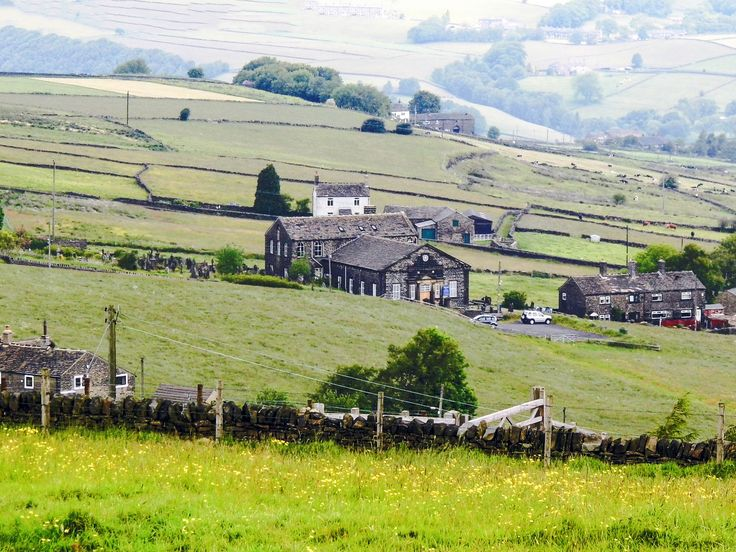 The church in the centre of the picture is the Steep Lane Baptist Chapel which stands high above the Calder Valley at Sowerby. The church yard has outstanding views of of the surrounding valleys and towns.