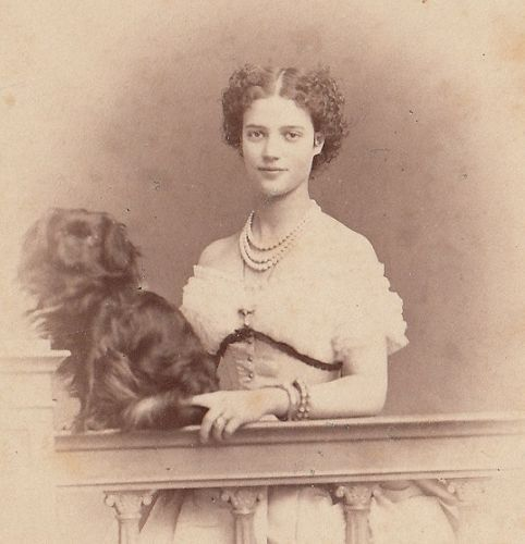 A young Maria Fyodorovna, mother of tsar Nicholas II of Russia, posing with one oh her pets