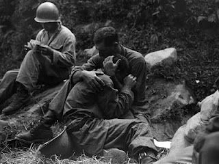 Shell-shock during World War II. I love this photo. It shows so much in this simple scene from war.
