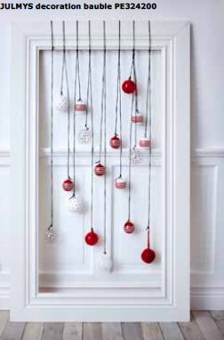 Cute! Hang baubles from doors, windows or frames to create a festive display.