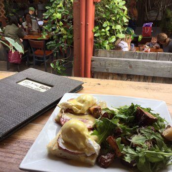 Photo of Fig Tree Cafe - Pacific Beach, CA, United States. Traditional benny with fancy potatoes. Also a view of the backyard seating