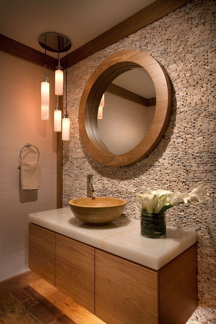 Earth tones and textures inspire this space and make a statement. W Design Interiors.