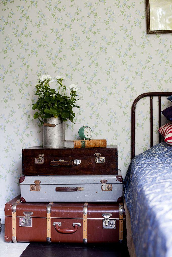 home, interior, vintage suitcases, storage, side table, bedroom, floral wallpaper, flowers, bed