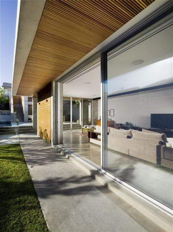 Large glazing windows in contemporary luxury l shaped clovelly residence design
