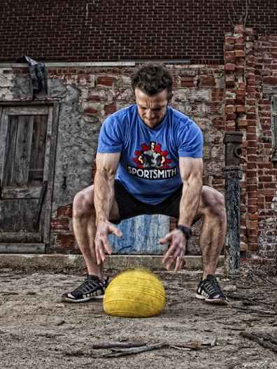 Breck from CrossFit Jenks using a D-Ball from Sportsmith.