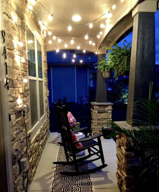 life love larson string lights on the front porch - Patio Ceiling Lighting Ideas