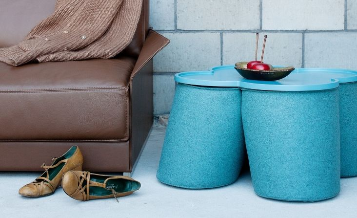 The Trefle stool/chair designed by Noti and covered in blue Wool fabric from Dekoma