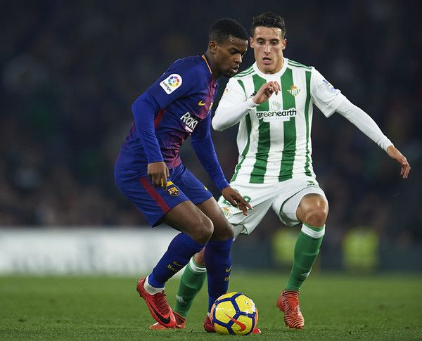 Nelson Semedo of FC Barcelona (L) competes for the ball with Cristian Tello of Real Betis Balompie (R) the La Liga match between Real Betis and Barcelona at Estadio Benito Villamarin on January 21, 2018 in Seville, . - 45 of 81