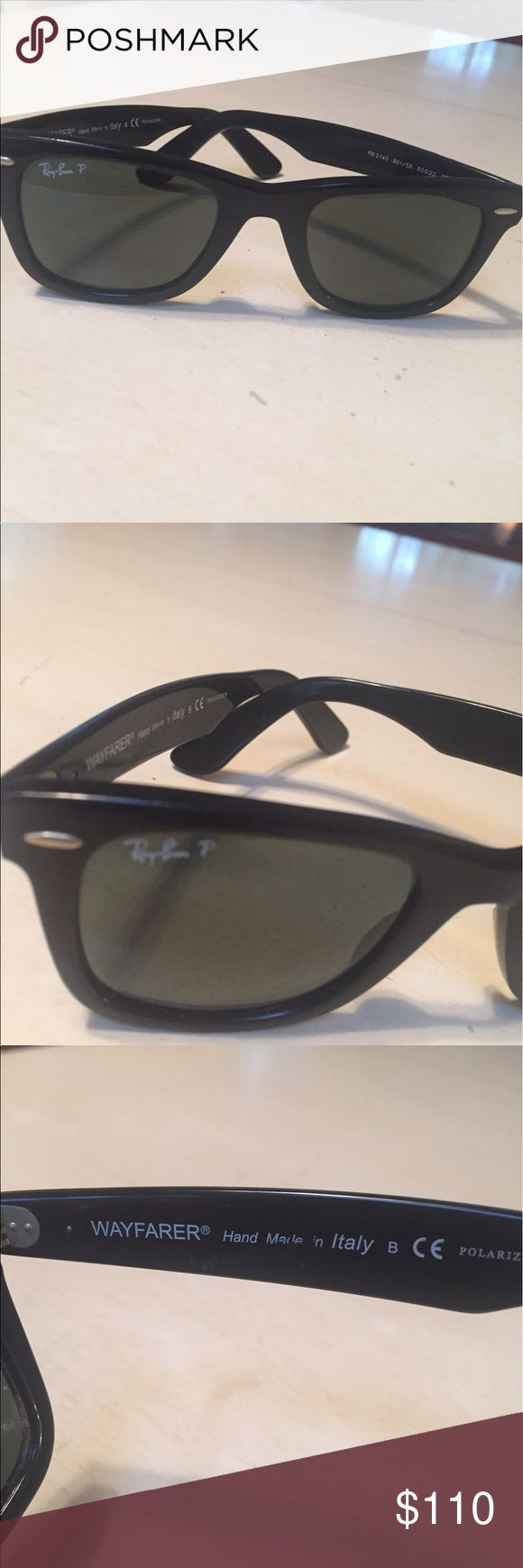 Original Ray Ban Wayfarer sunglasses Ray Ban Wayfarer sunglasses with black polarized frames and lenses.  Excellent condition. Ray-Ban Accessories Sunglasses