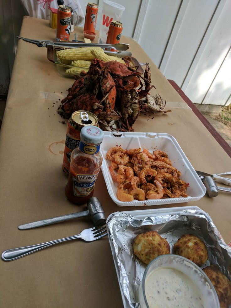 [4048x3036] Mid-Atlantic summer feast. Steamed crabs and shrimp sweet corn and broiled crab cakes. And beer. [OC]