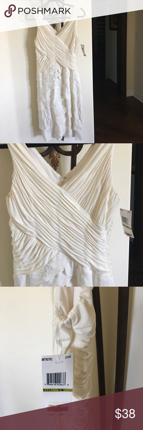 Cream cocktail dress. Very complimentary. Size 14 but wears more like a 12. Cream color fully lined. Zips in back. Sangria Dresses Midi