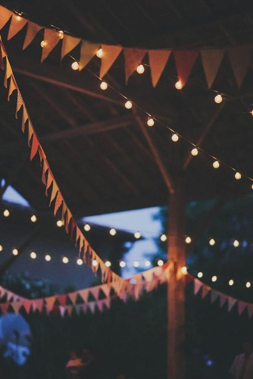 String up pennant garlands and cafe lights at your outdoor celebration