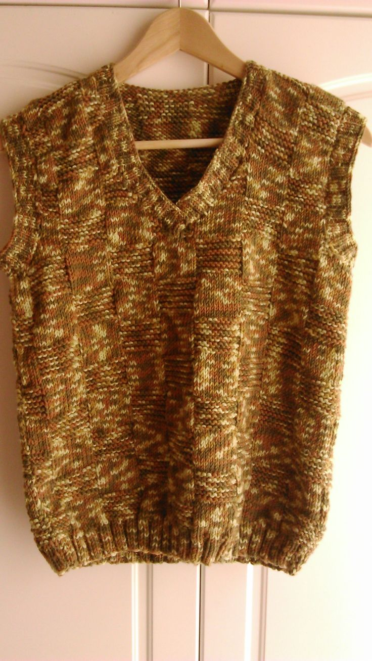 Hand-knit vest, made with brown-colored 50% woolen mosaic yarn.