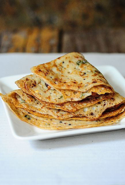INSTANT WHEAT DOSA 2 cups of wheat flour (atta or chapati flour)  4-5 cups of water  1 tsp of salt  2 tsp of oil  1/4 tsp of black mustard seeds  1/2 tsp of split urad dal (ulutham paruppu or uzhunnu parippu)  2-3 dry red chillies, cut into pieces  A few curry leaves, torn into pieces  3-4 shallots (chinna vengayam or ulli), minced